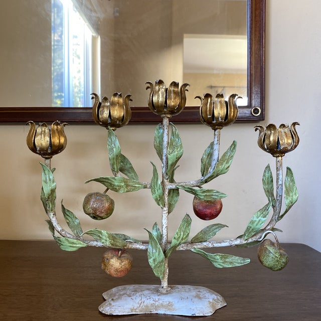 Listing is for a gorgeous candelabra from France. Made of metal, iron, the candelabra is decorated with fruit and foliage.