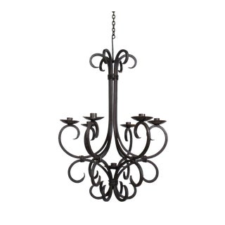 Rustic Hand Made Iron Candle Chandelier For Sale