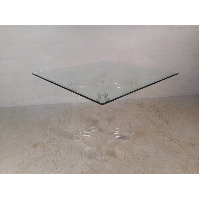 This gorgeous vintage modern dining set includes a Lucite base table with a glass top and four dining chairs. The stylish...