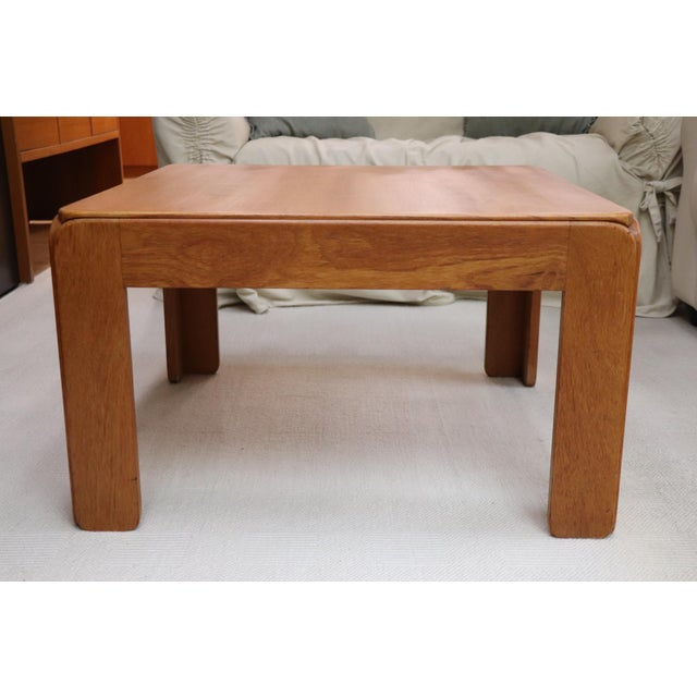 Vintage Danish Modern solid teak side table. Made in Denmark by Niels Eilersen. We love the softly curved, beefy edge...