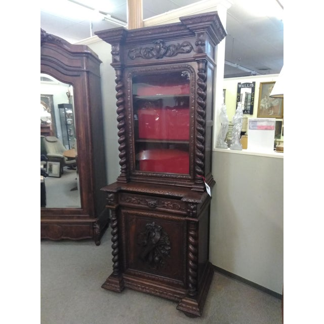 Antique narrow French Hunter cabinet or bookcase from the 19th century detailed hand carvings, door open to reveal and...