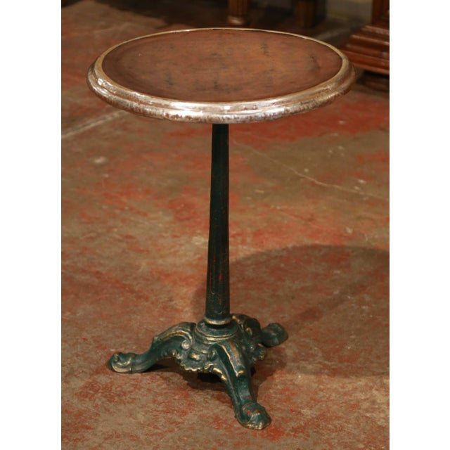 Decorate a patio or a garden with this elegant antique bistro table, crafted in France circa 1880, the side table sits on...