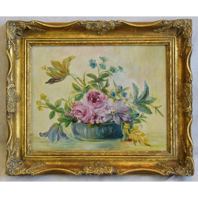 Early 1900s floral tablescape still life oil painting of a vase full of flowers. Unsigned. Displayed in a wood frame....