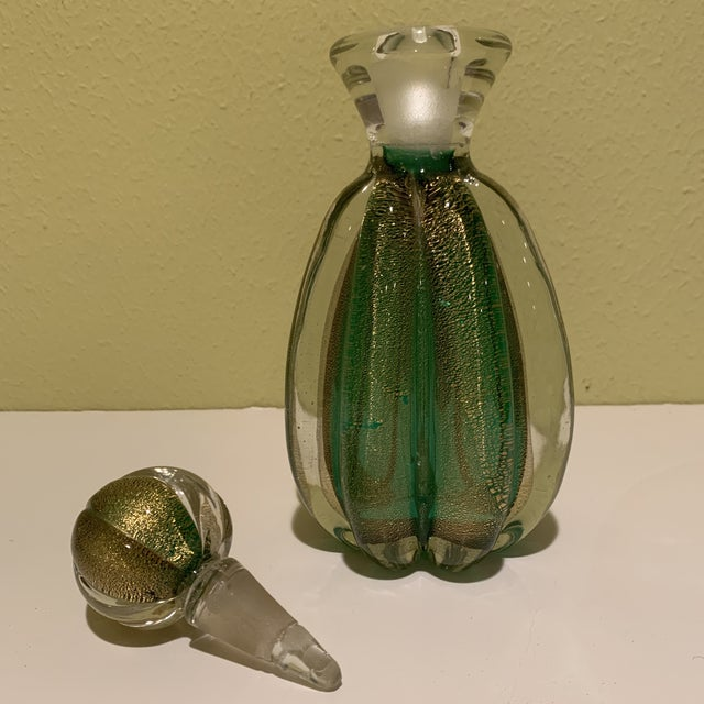 This gorgeous emerald green and gold Mid Century Italian Murano bottle/decanter is filled with gold flecks often seen in...