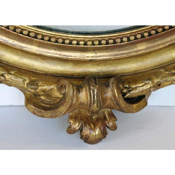 Napoleon III A Finely-Carved French Napoleon III Oval Giltwood Mirror with Shell Crest and Floral Garland For Sale - Image 3 of 5
