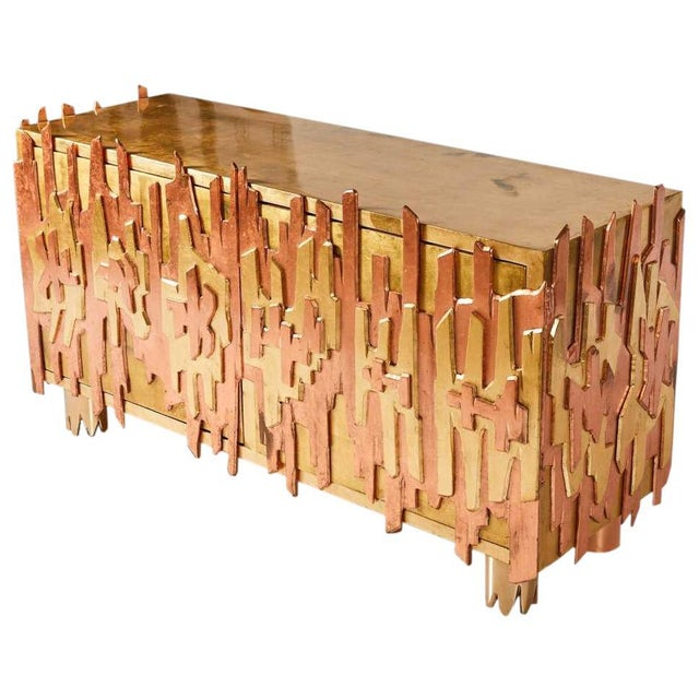 An incredible credenza by Pedro Baez of Mexico City. A rectilinear, gold-leaf, double-door, wood cabinet adorned on three...
