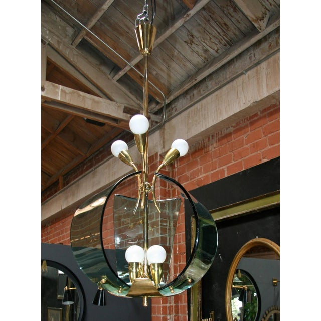 1950s fantastic fixture! What's not to like brass, handblown green Murano glass and brass.