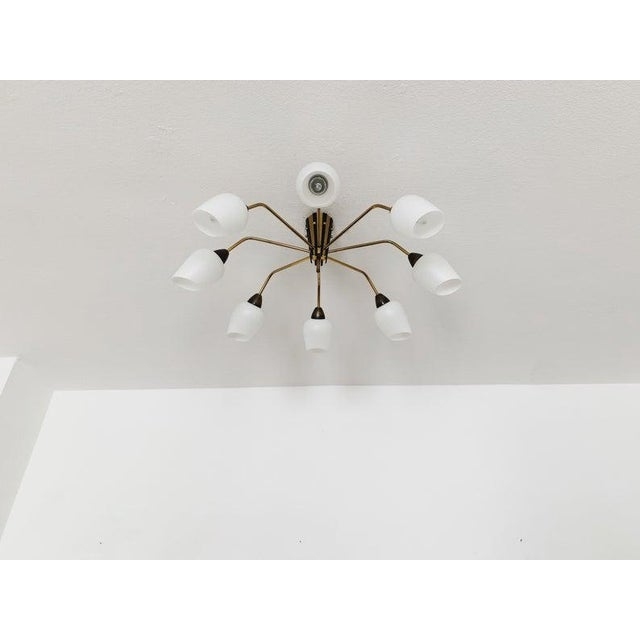 Extraordinarily beautiful and large golden Sputnik ceiling lamp from the 1950s. Wonderful design and very high quality...