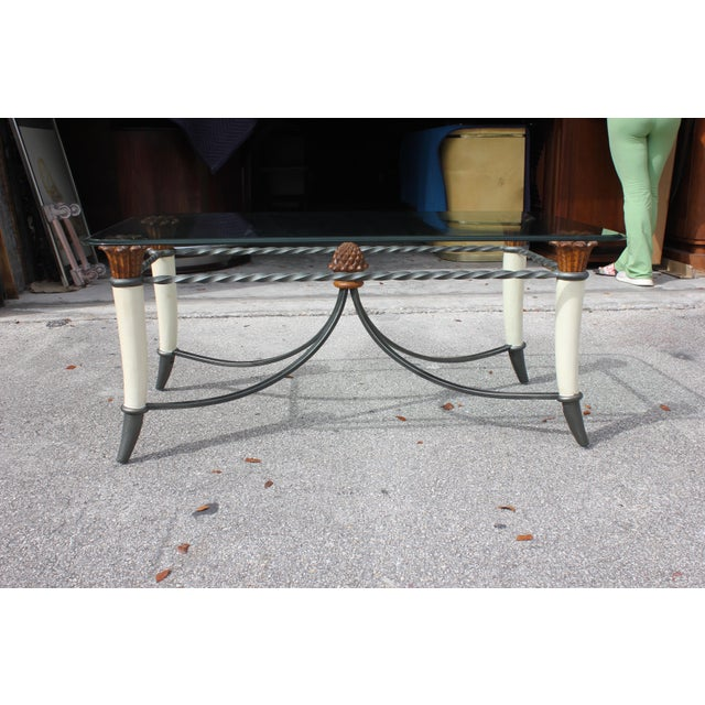 Beautiful mid-century modern solid mahogany Horn Supports with iron detail glass top coffee table. Made in the 1970s....
