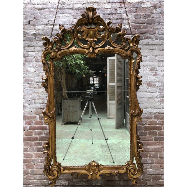 Magnificent French carved gilt wood mirror, Louis XV. Provenance private collection Paris. This Louis XV mirror, due to...