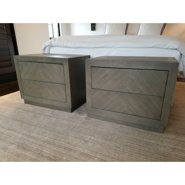 HERRINGBONE NARROW NIGHTSTAND Crafted of oak and fine veneers Constructed of close-set hardwood panels and precisely...