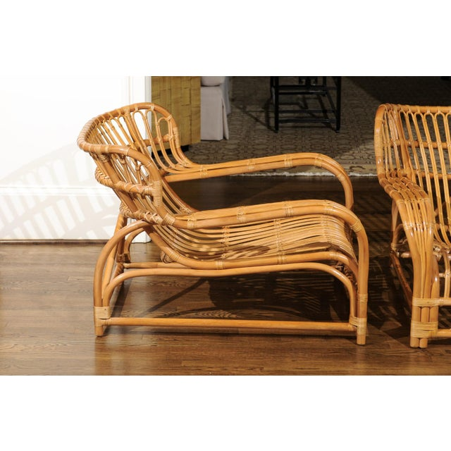 A spectacular pair of custom made rattan lounge chairs, circa 1995. This particular design was inspired by the...