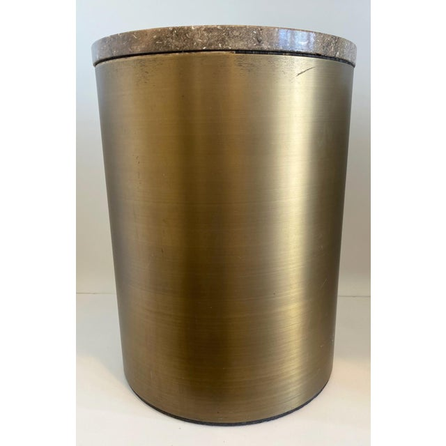 Paul Mayen style cylinder matte bronze drum table with a stone top. The top separates from the base, a sleek beautiful table.