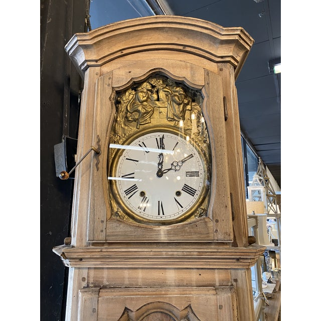 19th century French Louis XV provincial grandfather clock in bleached walnut. Solid peg and dowel constructed case with...