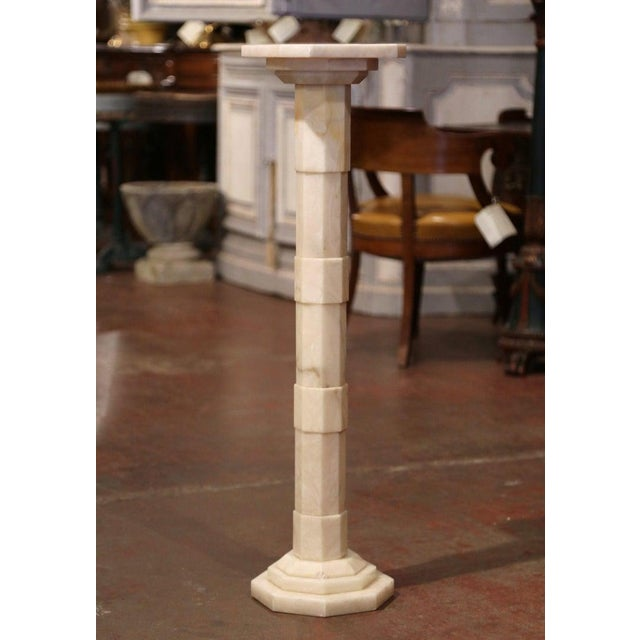 This elegant, antique white marble pedestal table was crafted in France, circa 1920. The Art Nouveau pedestal sits on a...