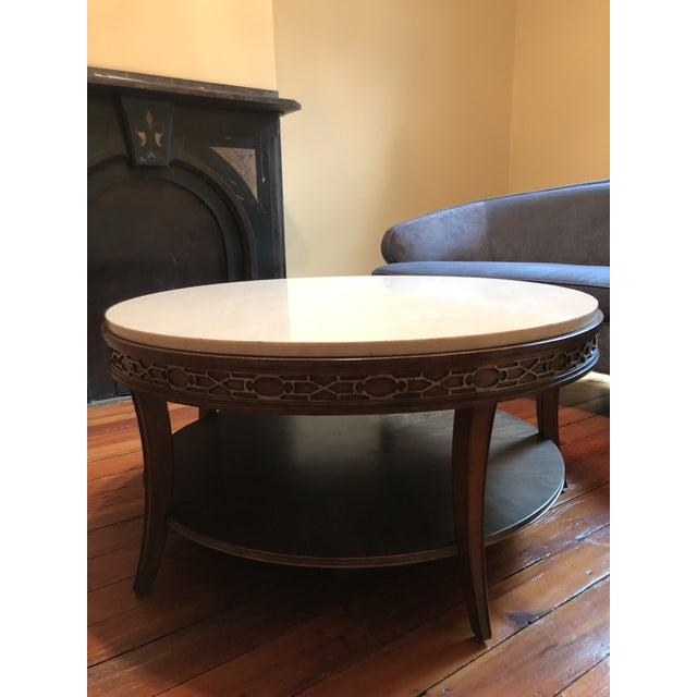 Brand new, just delivered, never used. Gorgeous white marble top, classic/transitional design, lovely bronze accent...