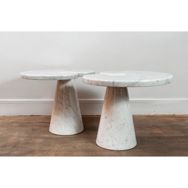 Pair of side tables from Mangiarotti's Eros series. Carrare marble The marble top held by a marble conic pedestal. Design:...