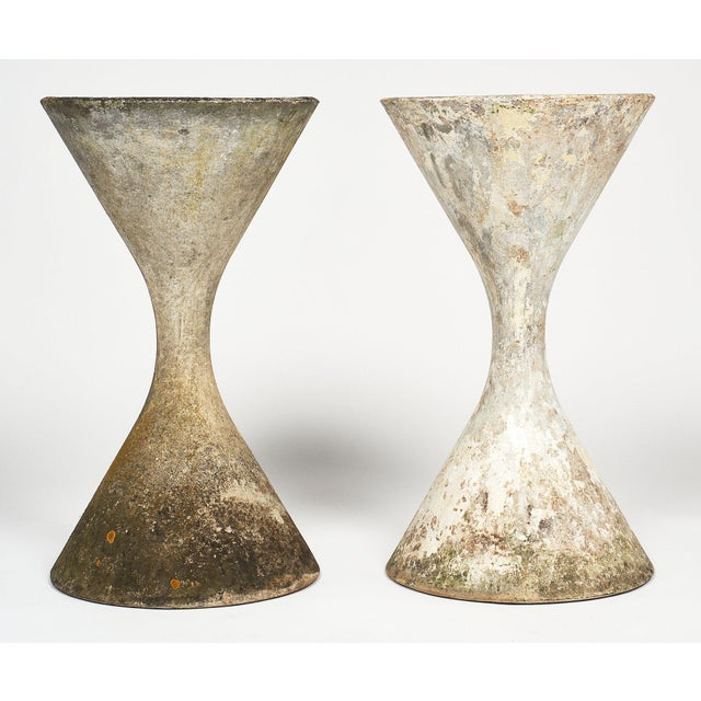 Iconic pair of mid-century jardinieres by Willy Guhl, each in the shape of an hour glass. They are in great shape with no...