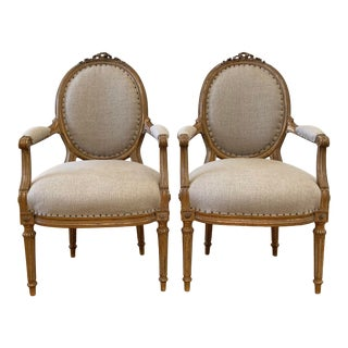 Antique Pair of Gilt Wood Open Arm Chairs Upholstered in Natural Linen For Sale