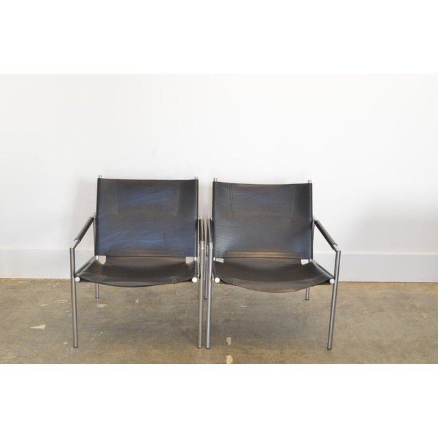 Pair of Martin Visser lounge chairs in black leather mfg: Spectrum, Holland 1965 / model SZ02. Dutch modernist chairs with...
