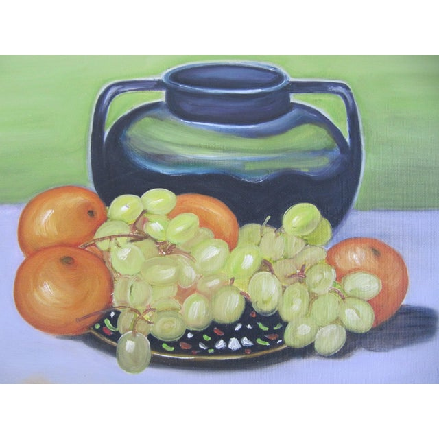 Beautiful vintage still life painting of a vase and a platter of grapes and oranges. Signed lower right.