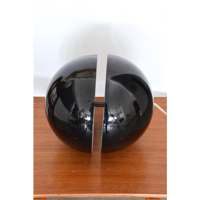 A 2Oth Century vintage black space-age style spherical table lamp by Design Andrea Modica for Swiss manufacturer Lumess...
