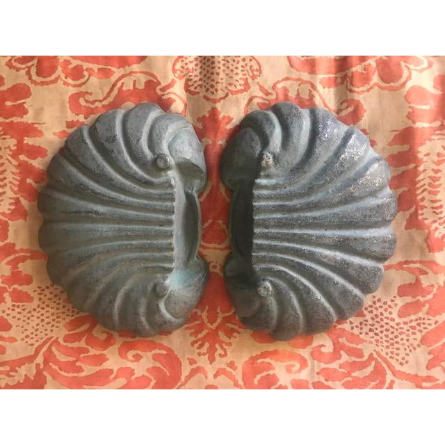 Great pair of heavy metal dishes. They are stylized scallop shells. Great for indoor or outdoor. Key and change catch all...