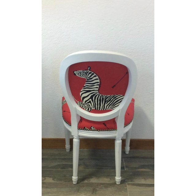 Classic Louis XV style round back side chair. Seat and rear chair panel are upholstered in bold, large scale printed...