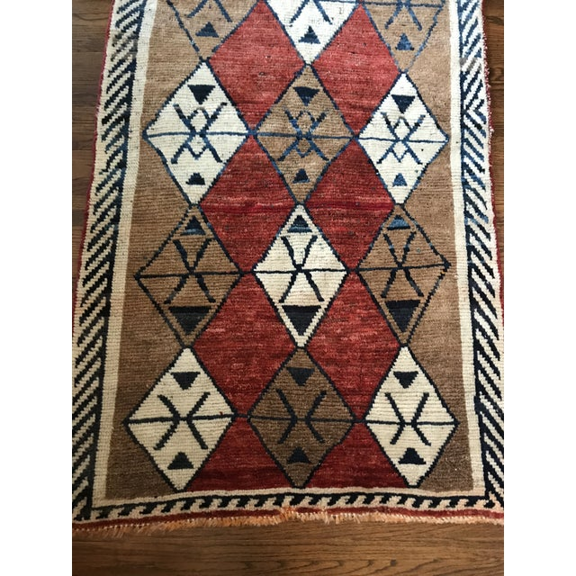 Unique colors on this beautiful hand knotted rug, made in Iran. Pattern is simple with a touch of a Moroccan feel.