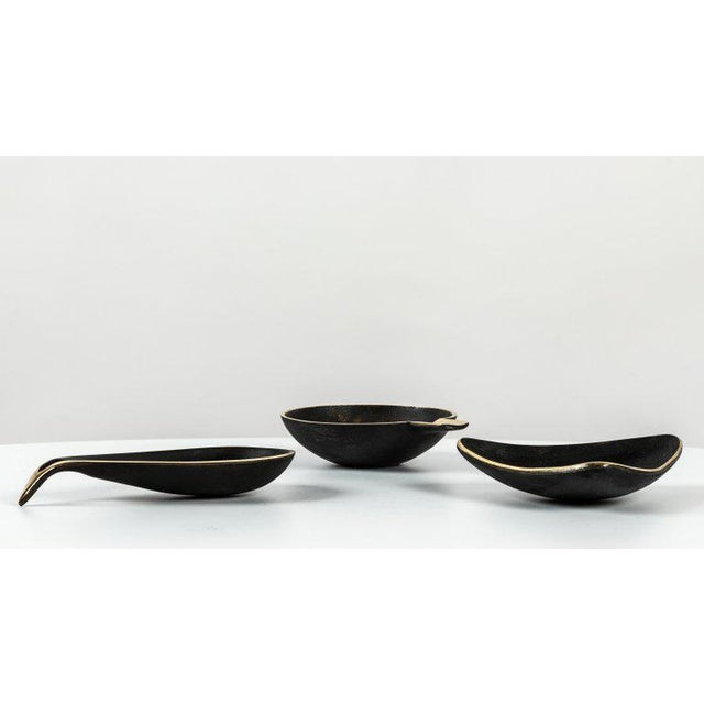 Set of three Carl Auböck brass bowls. Includes one each of Models #3904, #3844 & #4082. Designed in the 1950s, these...