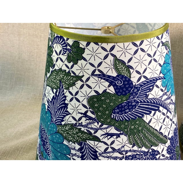 """A Pair of lampshades handmade with a hand printed cotton fabric with a flora and fauna pattern. Measurements top,7"""" side..."""