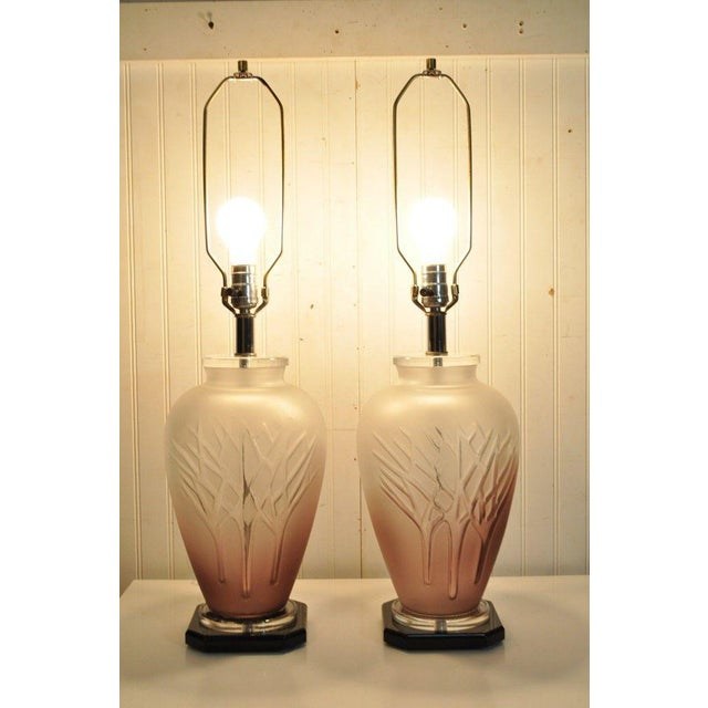 Item: Pair vintage Mid Century Modern style glass lamps. The bases of the lamps are black lucite, while the bodies are a...