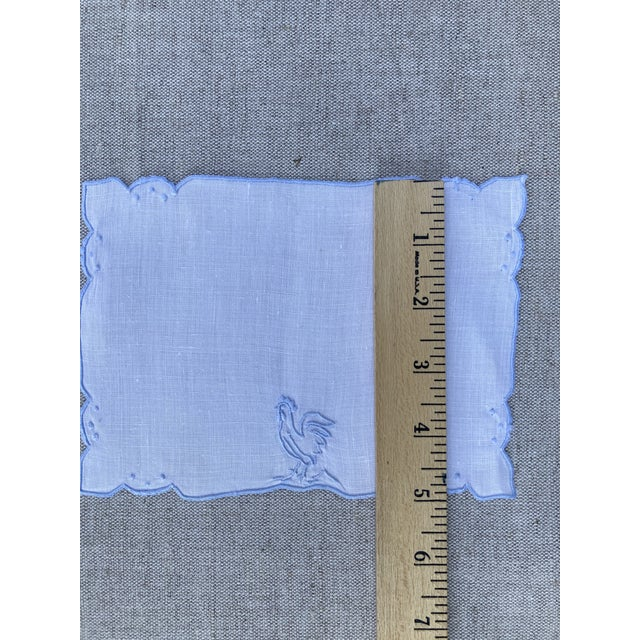 A set of 8 embroidered cocktail napkins with a charming rooster motif, starched, pressed and ready to serve.