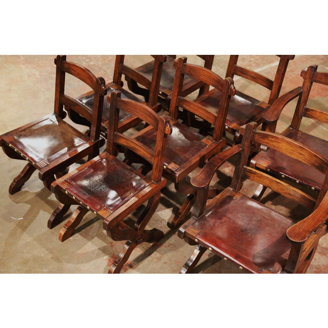 These elegant dining chairs were crafted in Spain, circa 1890. Carved from solid oak, each chair has a pitched back with...