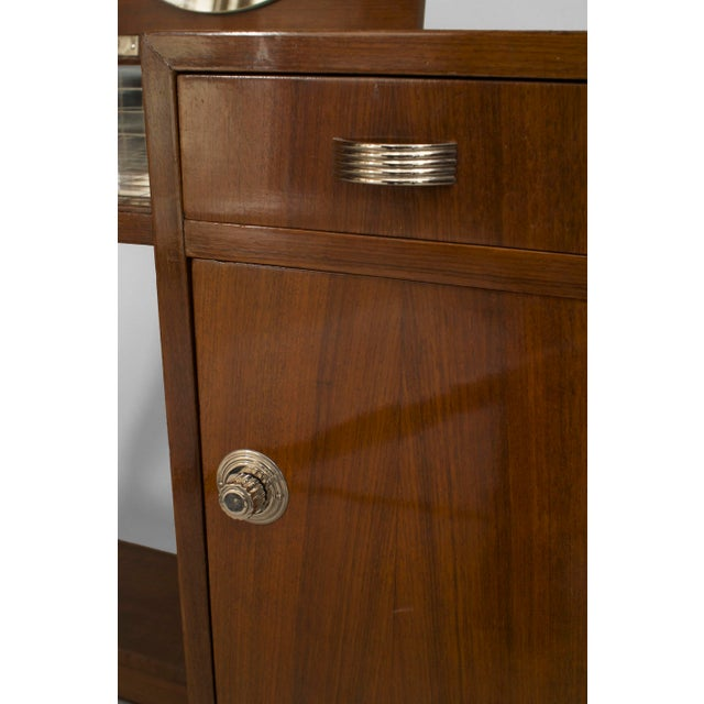 French Art Deco mahogany dressing table with a side door under a drawer with a folding mirror having a brown leather top...