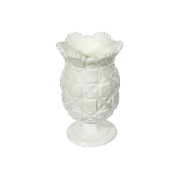 1960s footed white glass vase with a textured block design.