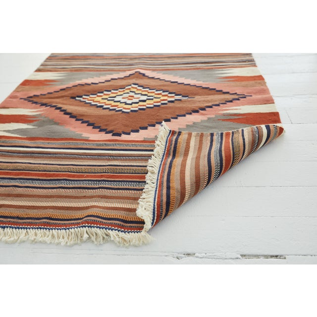 This is a contemporary tribal style wool rug. The piece was hand-knotted from wool. Style of the rug : Azerbaijan...