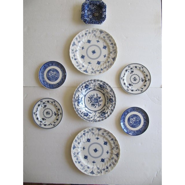 Nine decorative blue and white bowls, and plates with birds, flowers and chinoiserie patterns. A beautiful addition to...