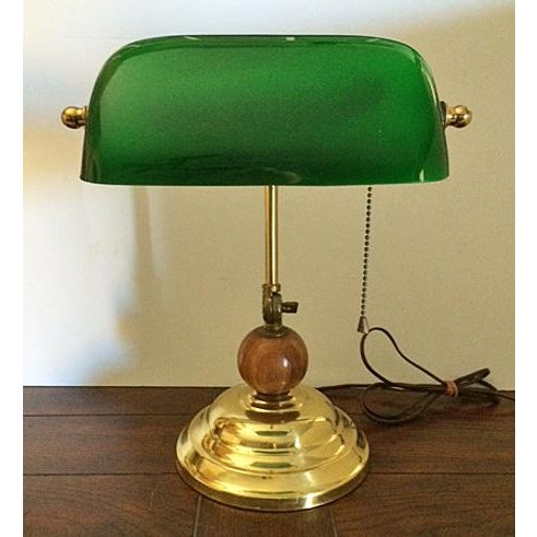 Exceptional and unique vintage brass bankers desk lamp with an emerald green glass shade. What is extra special about this...