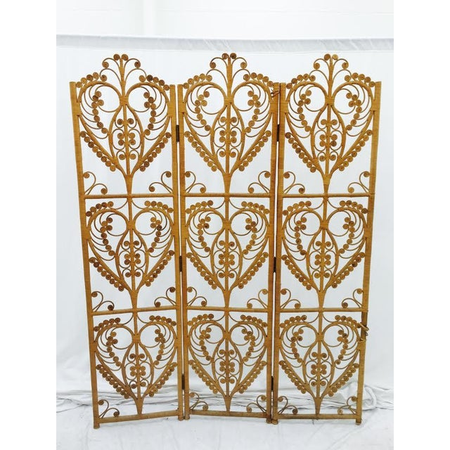 Vintage jungalow / bohemian style screen in natural colored woven wicker. Peacock accents, iconic to the 1970s. Can be...