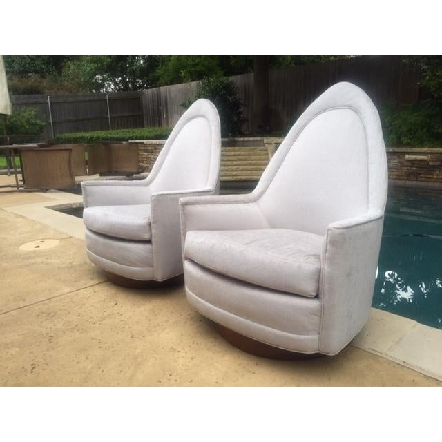 Rare pair of vintage sculptural Milo Baughman style swivel chairs. These were manufactured by Selig Imperial and are...