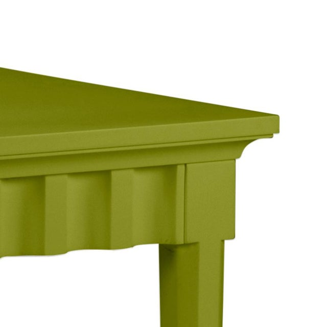 Scallop pattern design on console and finish is Benjamin Moore Dark Celery. Made of acacia wood.