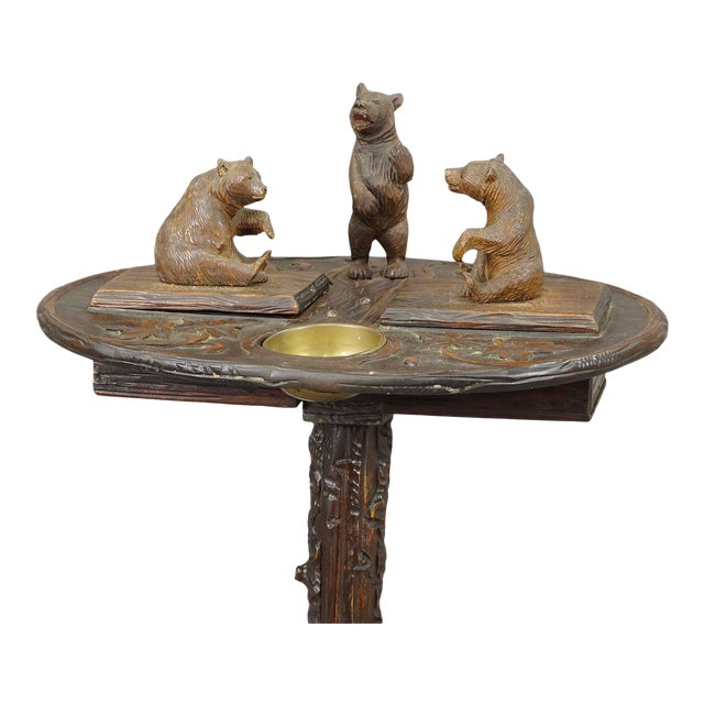 a fantastic carved smoker´s table with 3 lovely cubs on the table top and mother bear on the base, handcarved in...