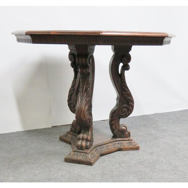 Solid walnut Italian style center table with massive carved legs ending in a claw foot