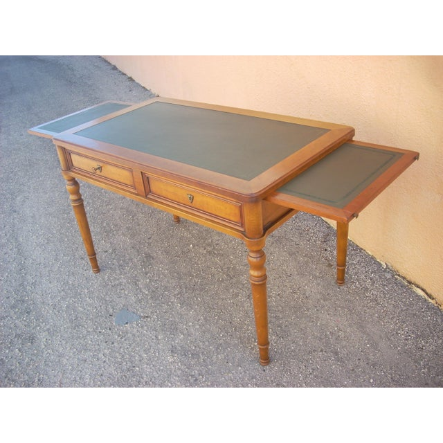Classic Grange French country design in rich honey colored wood. Desk top is hand tooled green leather which matches the...