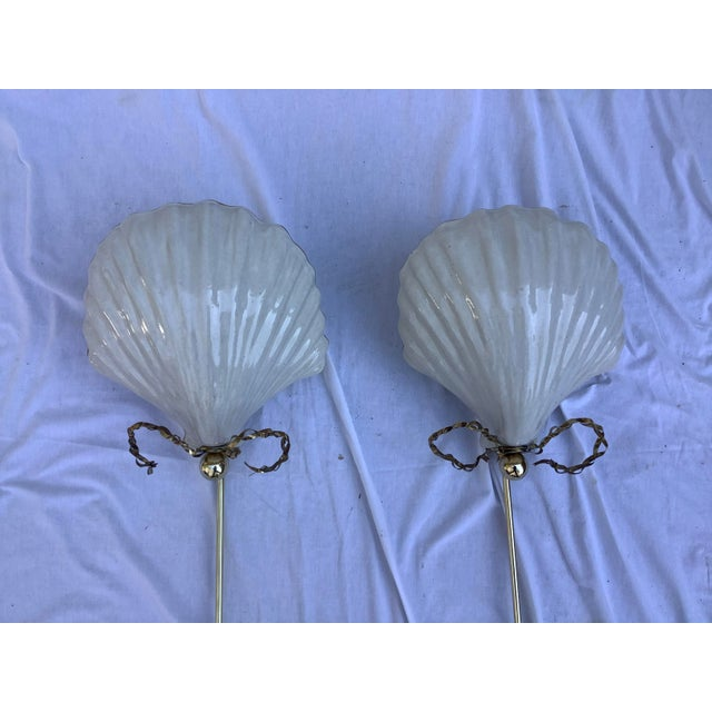 Very unusual, pair of large, pottery , shell wall sconces by Chapman Mfg. The sconces have brass accents, and brass rod...