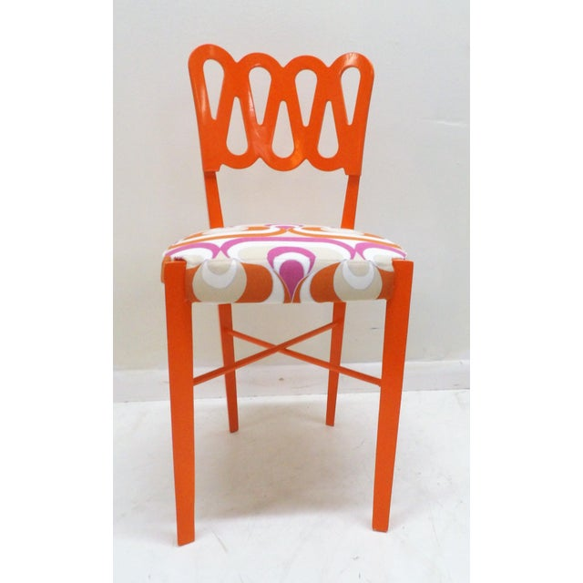 Creatively reinvented set of five dining chairs. Mfg unknown. The set feature an new bold orange lacquer finish as well as...