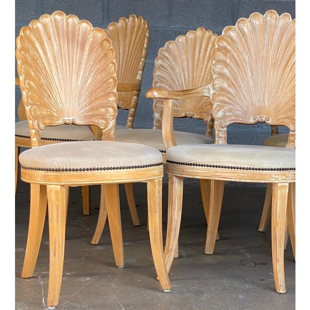 Fantastic set of four hand carved grotto chairs. Beautiful detail work on four shell backs. Two arm chairs and two side...