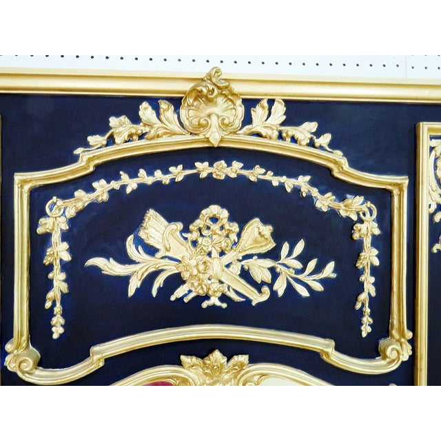 "Friedman Brothers Neapolitan style wall mirror. Carved with blue paint and gilt trim. The mirror, itself, measures 33.75""h..."