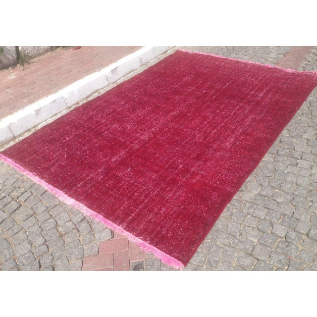 Hand-knotted Overdyed rug with an allover design on a purple field. This rug has great color and would be perfect for any...